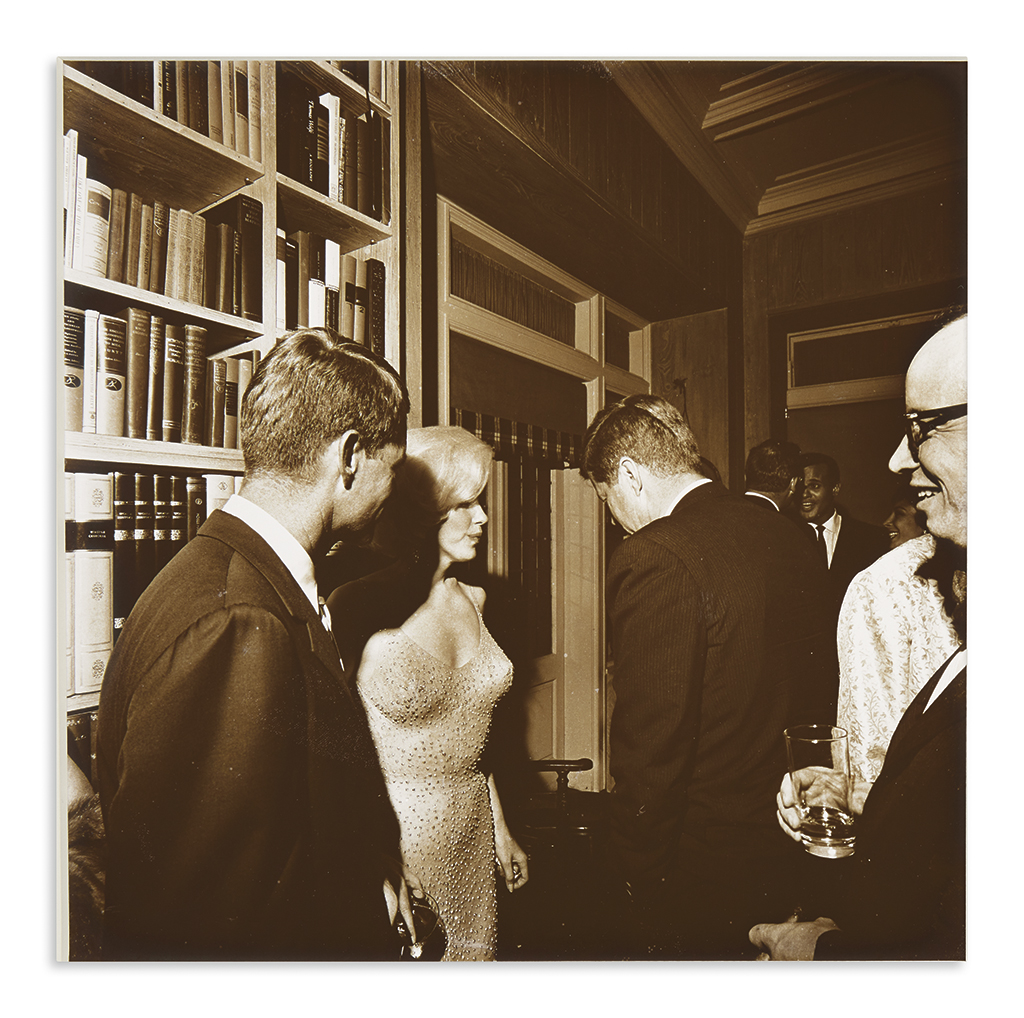 (KENNEDY, JOHN F.) Stoughton, Cecil W.; photographer. The only known photograph of Marilyn Monroe and John F. Kennedy together.