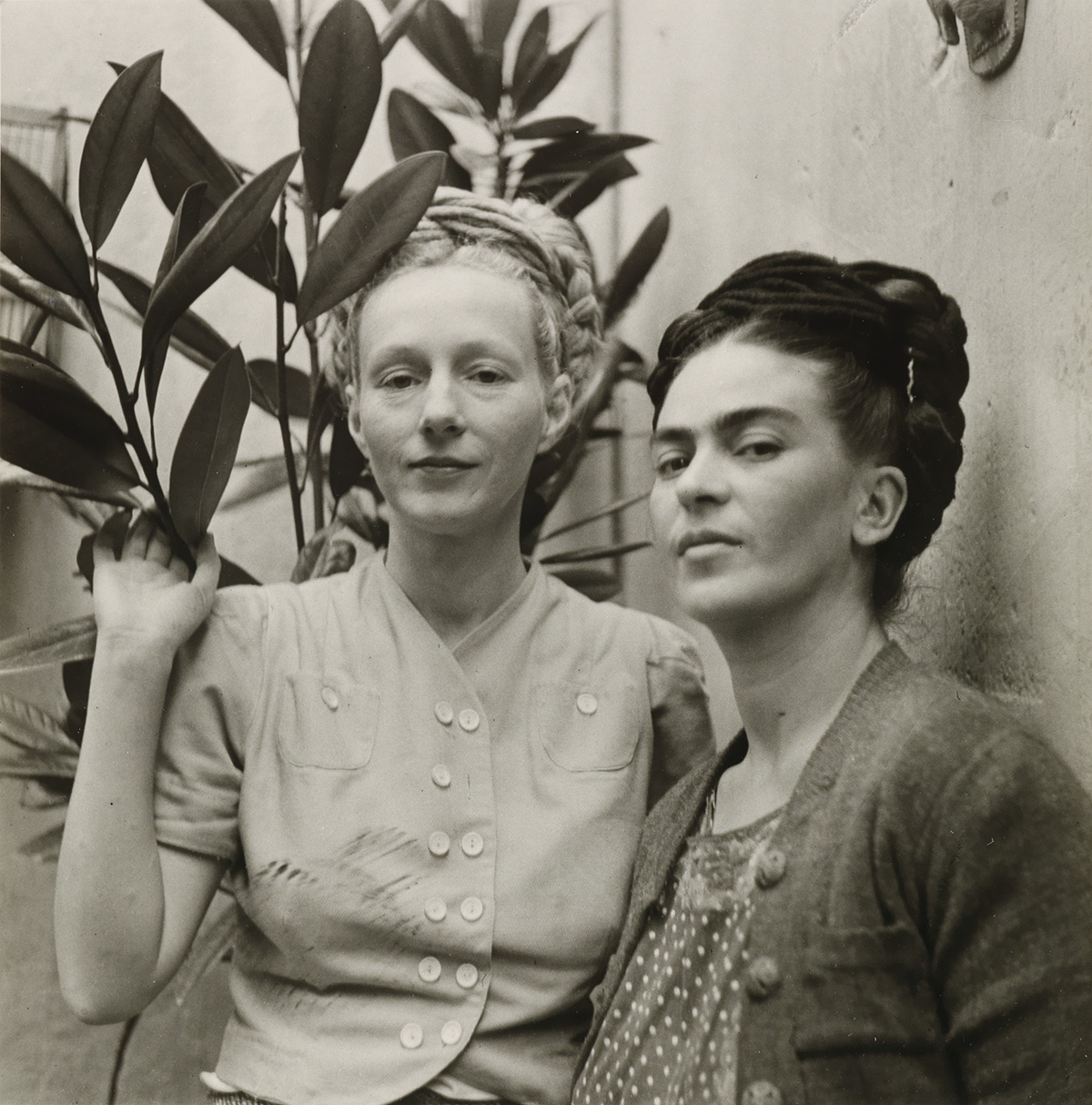 (DIEGO RIVERA) (1886-1957) Frida Kahlo and Emmy Lou Packard, in Coyoacan.