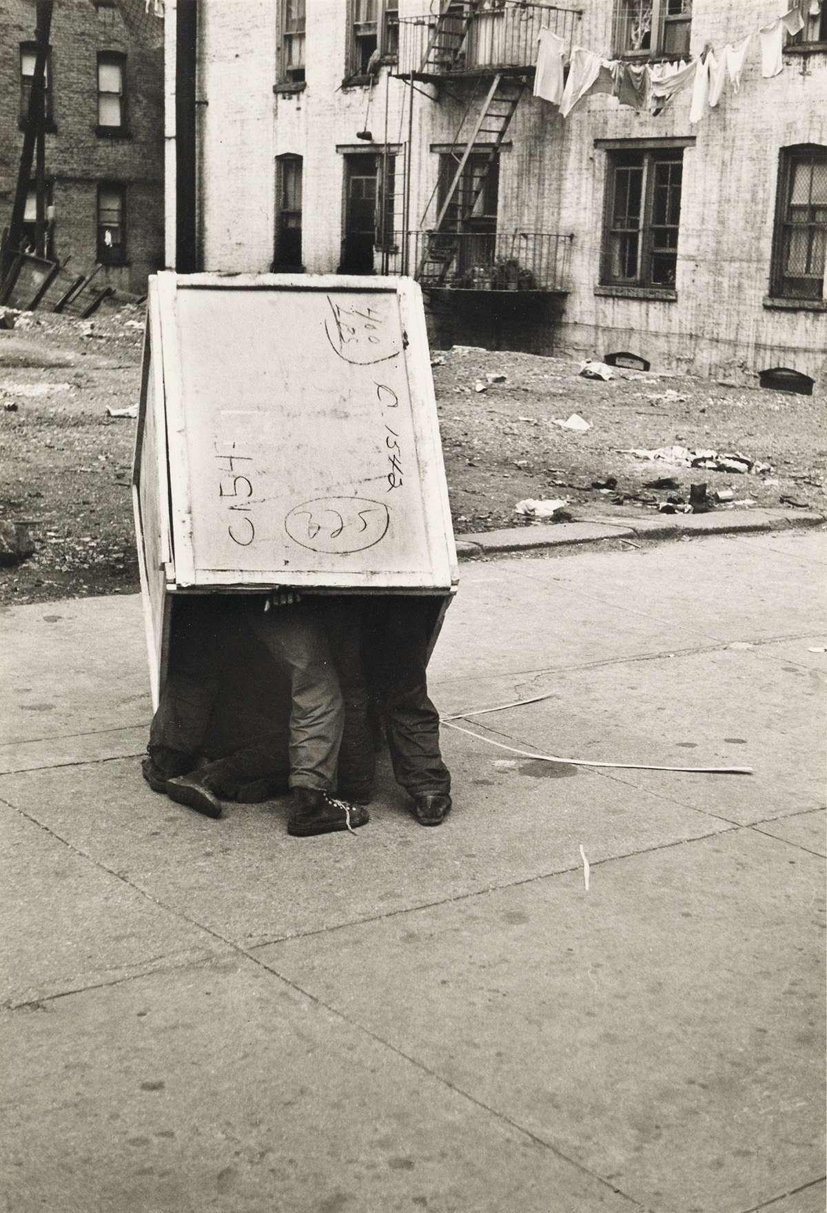 HELEN-LEVITT-(1913-2009)-NY-(boys-playing-in-a-wooden-crate)