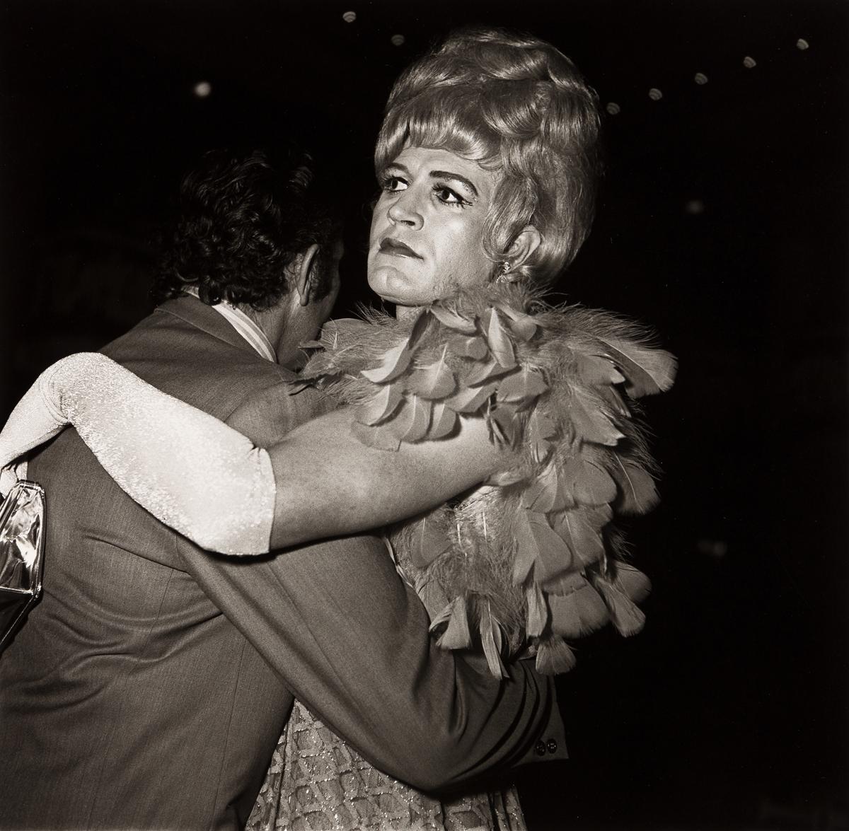 DIANE ARBUS (1923-1971)/NEIL SELKIRK (1947 - ) Two men dancing at a drag ball, NYC.
