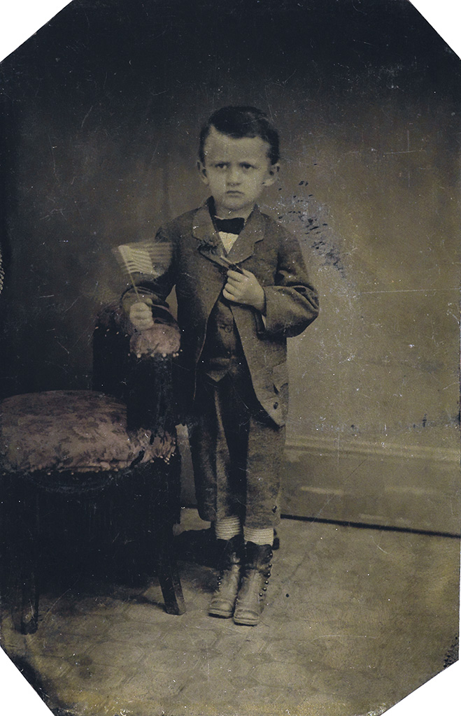(AMERICAN TINTYPES) Group of 11 patriotic tintypes shot in different photographers studios, with images of children holding the