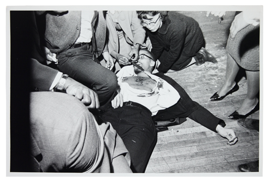 MALCOLM X. Group of six gelatin silver print photographs of Malcolm Xs Assassination;
