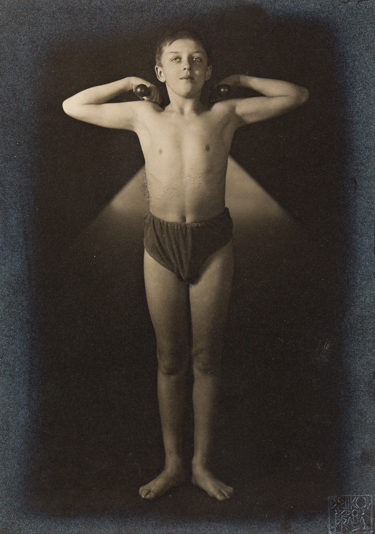 FRANTIŠEK-DRTIKOL-(1883-1961)-Boy-posing-with-barbells