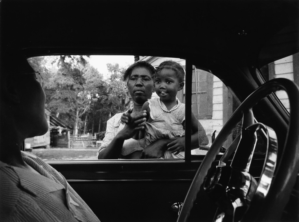 W. EUGENE SMITH (1918-1978) Woman and child by car window, from the Nurse Midwife photo essay in LIFE Magazine.