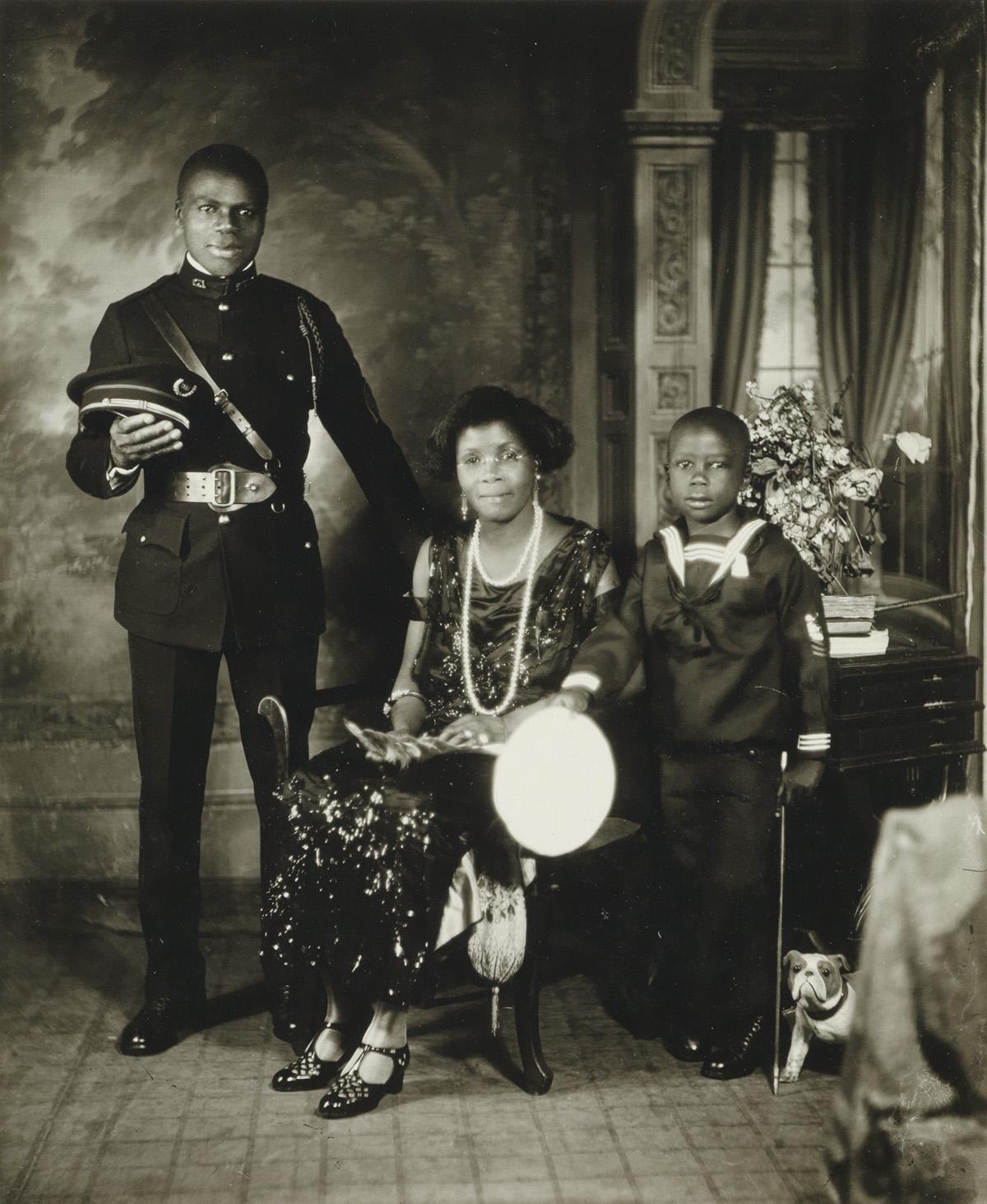 JAMES VANDERZEE (1886 - 1983) Untitled (Garveyite Family, Harlem).