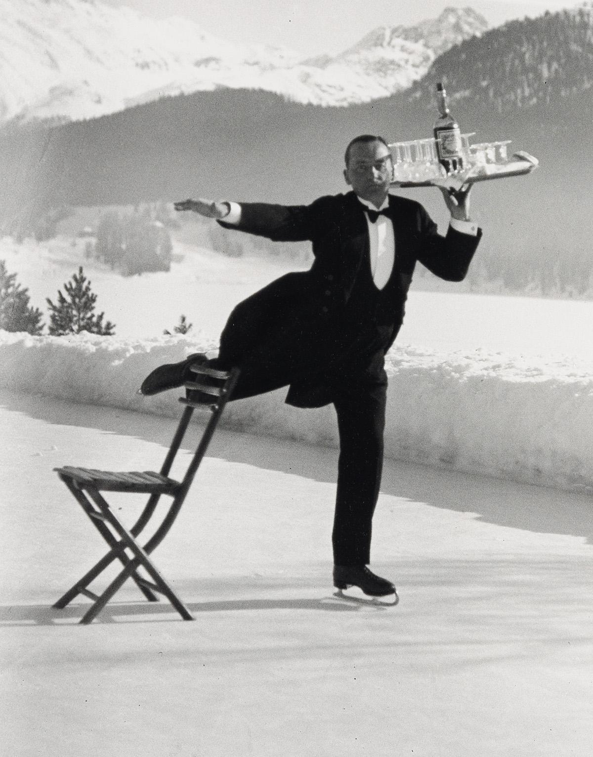 ALFRED EISENSTAEDT (1898-1995) Ice Skating Waiter, St. Moritz.