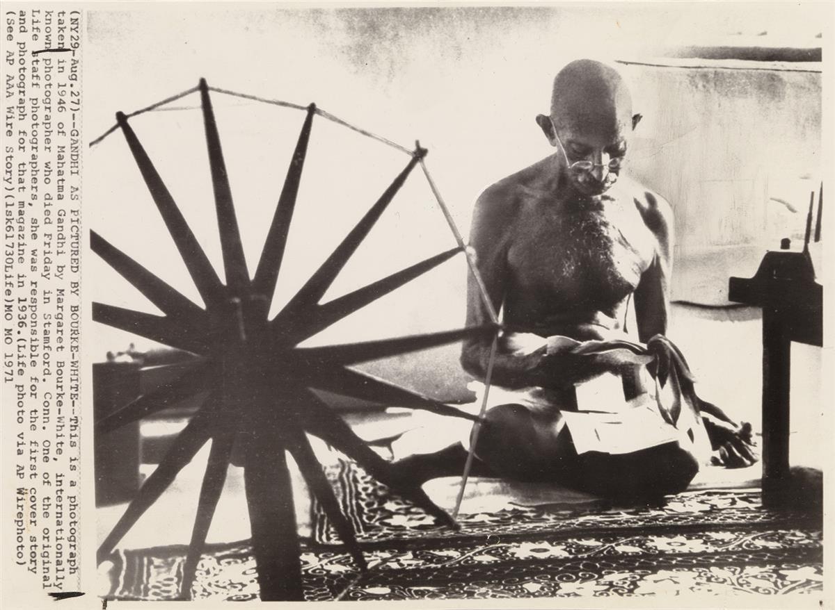 (MARGARET BOURKE-WHITE) (1904-1971) Gandhi and the Spinning Wheel.