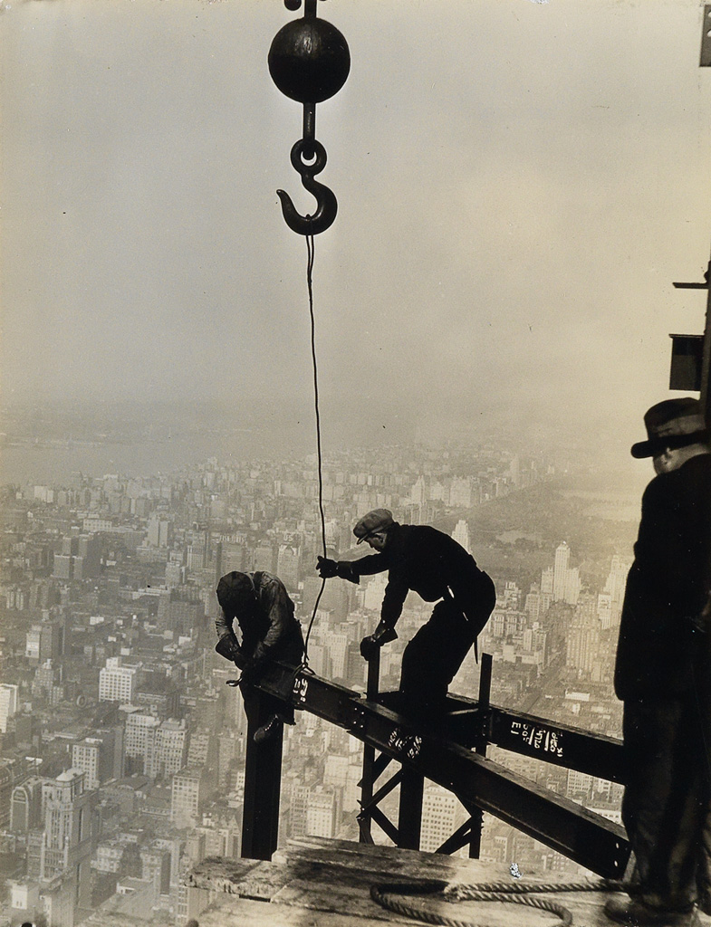 LEWIS W. HINE (1874-1940) High up on the Empire State Building, two construction workers attaching a beam.