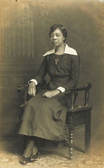 (PHOTOGRAPHY.) Group of 275 real photo post cards of African-American women, indoors, outdoors, portraits, etc.