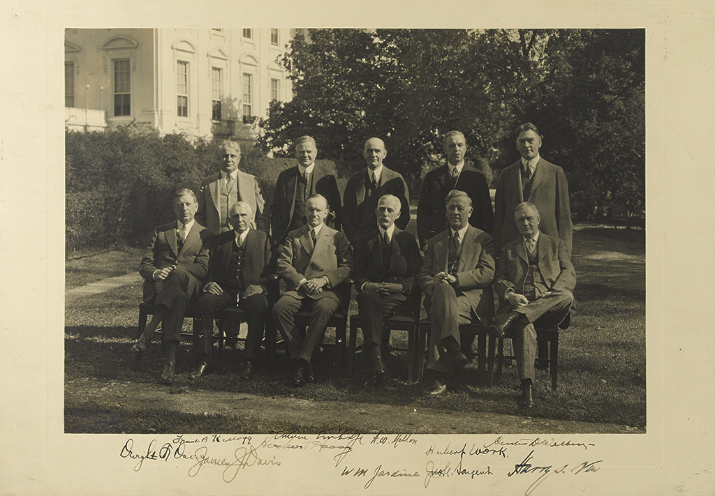 COOLIDGE, CALVIN; AND HIS CABINET. Group Photograph Signed, by Coolidge and each member of his post-election cabinet,