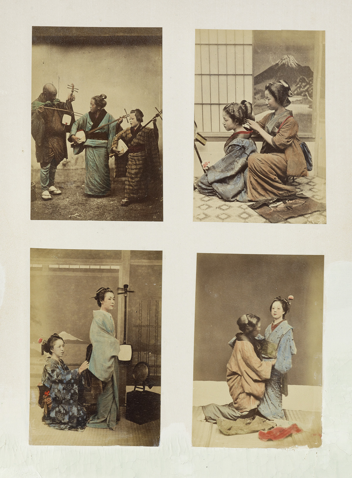 (JAPAN) A dynamic album with approximately 190 small-format photographs, most hand-colored.