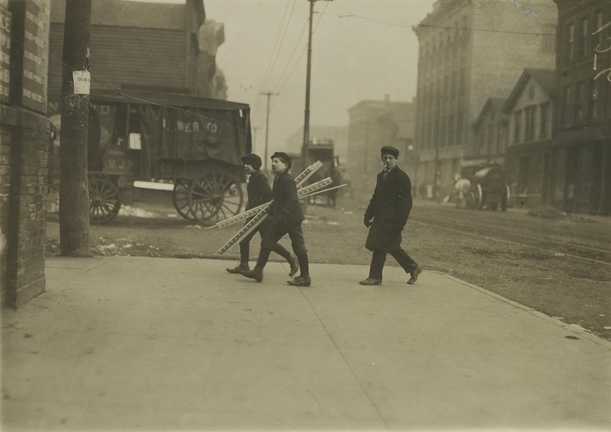 LEWIS-W-HINE-(1874-1940)-Boys-walking-and-carrying-boards