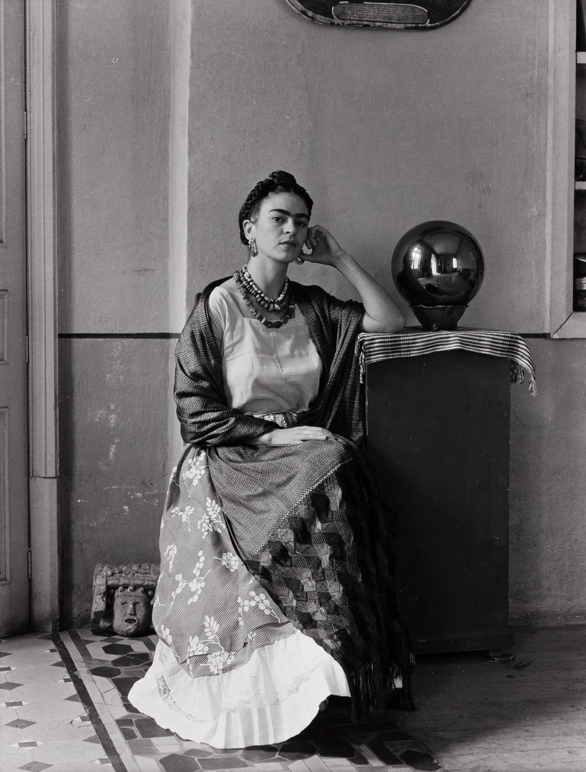 MANUEL ÁLVAREZ BRAVO (1902-2002) Frida Kahlo with globe.