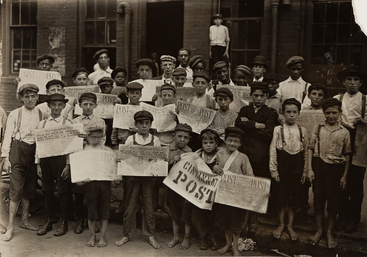 LEWIS W. HINE (1874-1940) A group of newsboys waiting at the newspaper office for the baseball edition, 5 p.m., Cincinnati, Ohio.