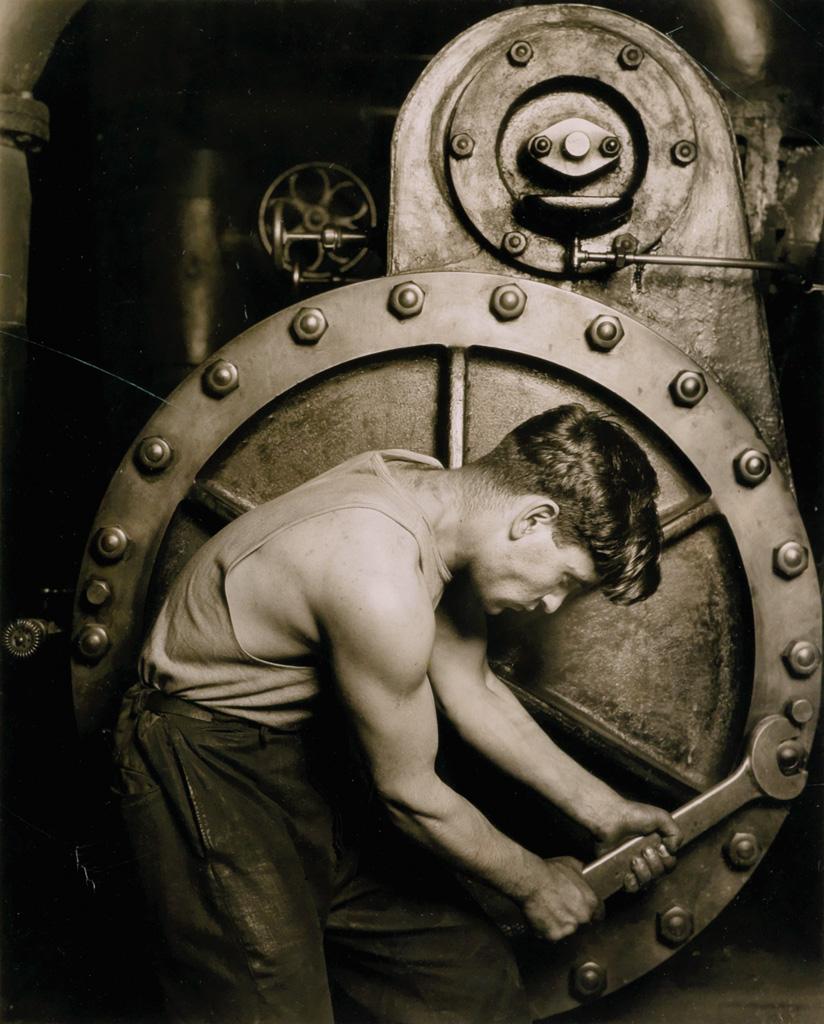 (LEWIS W. HINE) (1874-1940) Powerhouse Mechanic.