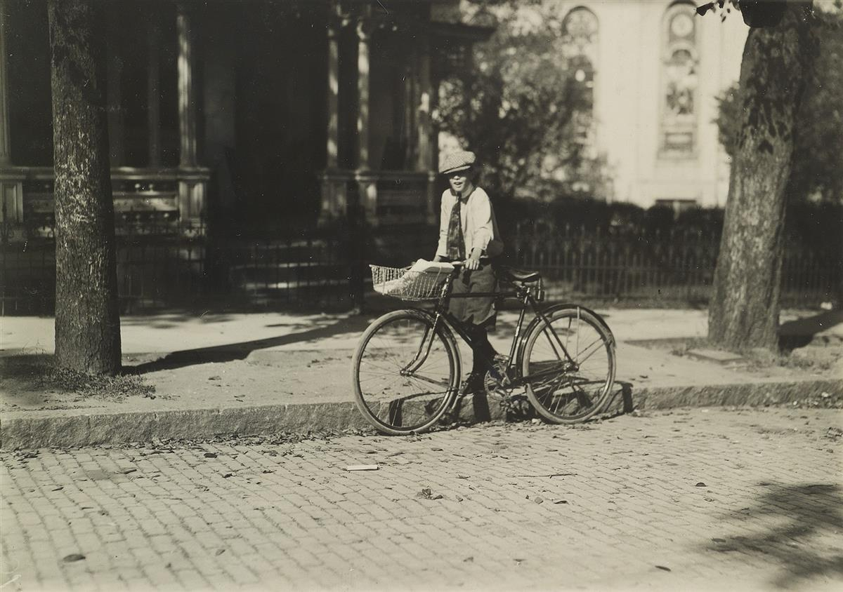 LEWIS-W-HINE-(1874-1940)-A-12-year-old-delivery-boy-for-a-Mo