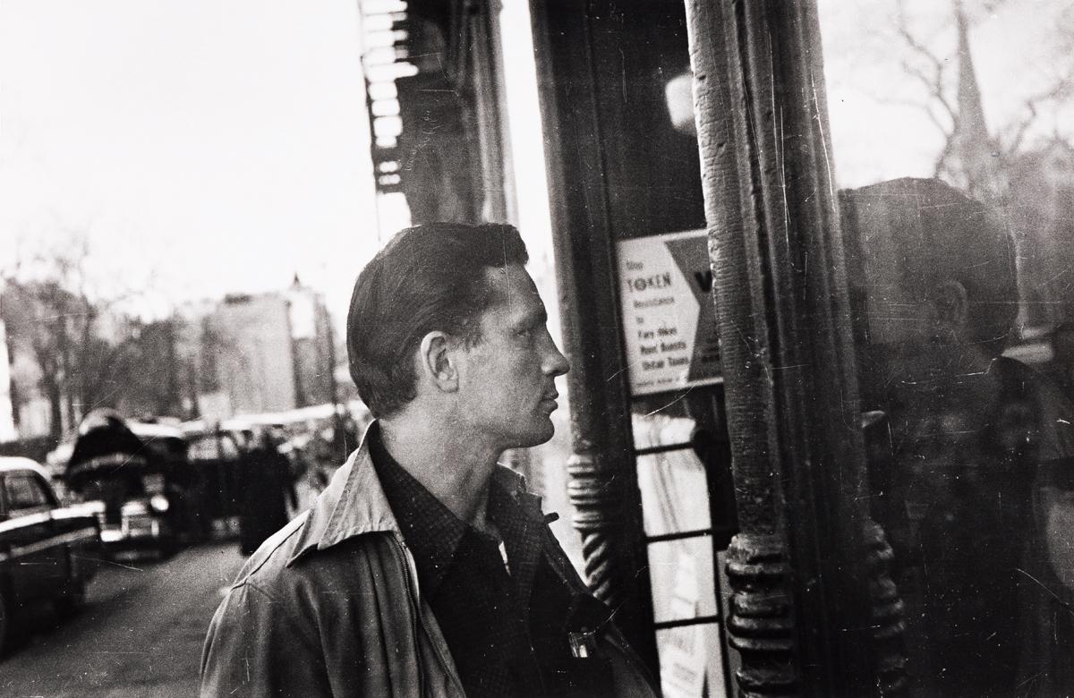 ALLEN GINSBERG (1926-1997) Jack Kerouac looking in barroom doorway.
