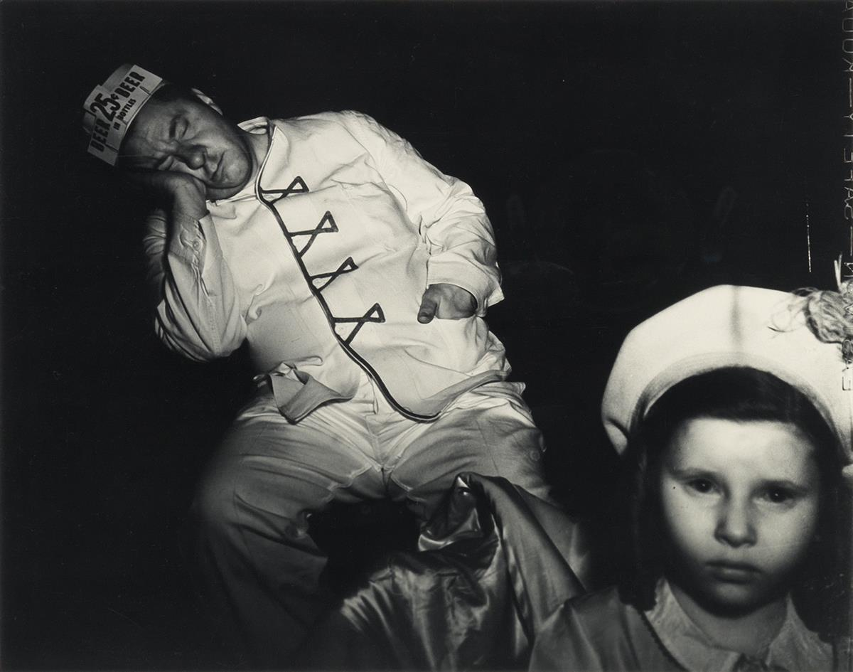 WEEGEE-[ARTHUR-FELLIG]-(1899-1968)-Tired-Businessman-at-the-