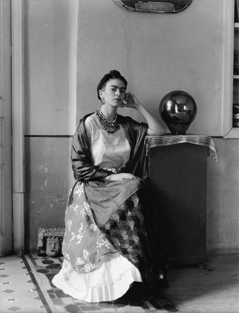 MANUEL ÁLVAREZ BRAVO (1902-2002) Frida with globe in Manuel Álvarez Bravos studio.