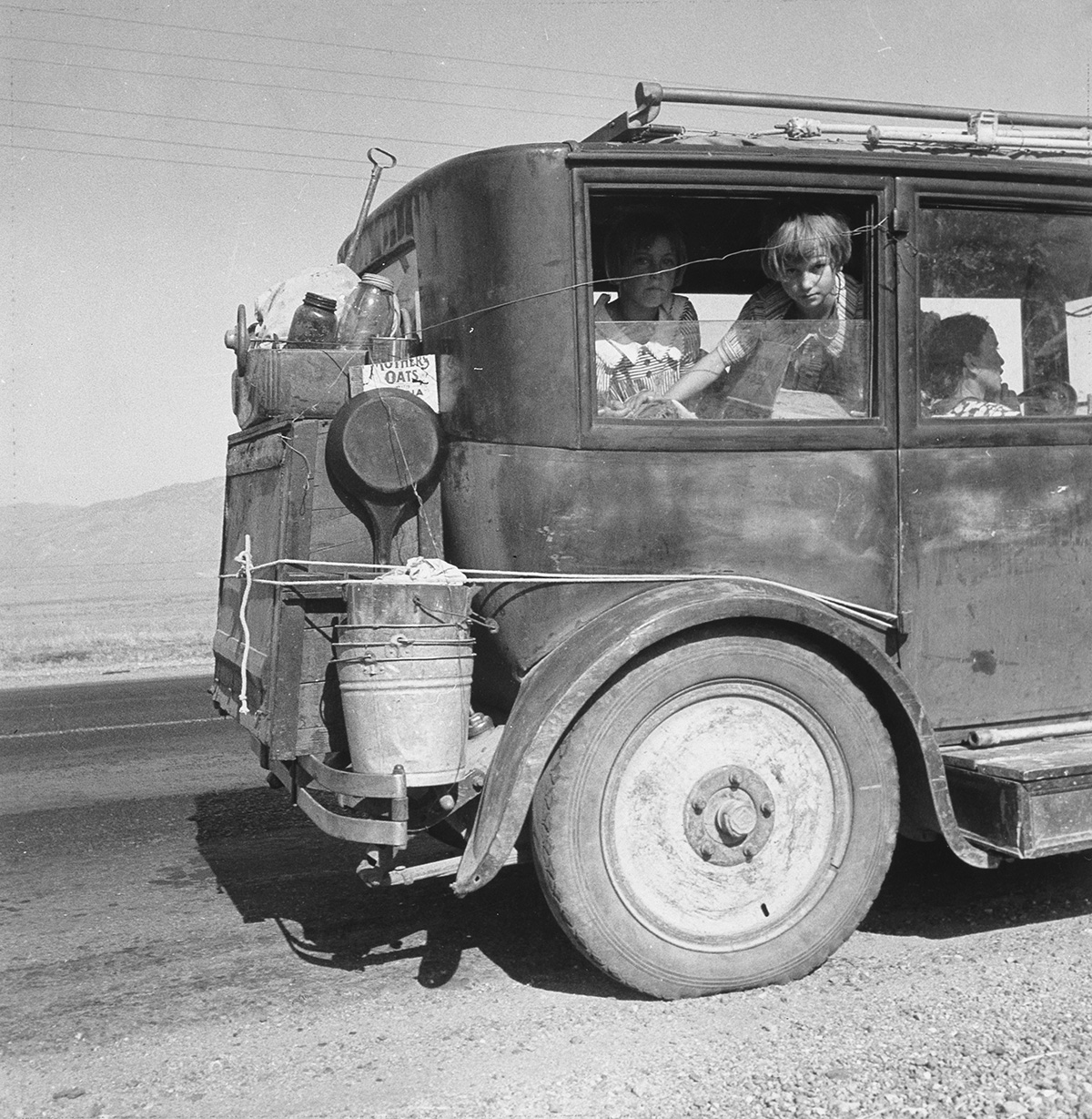 (DOROTHEA LANGE) (1895-1965) Drought refugees from Abilene, Texas who are following the crops of CA as migratory workers (Cars on the R