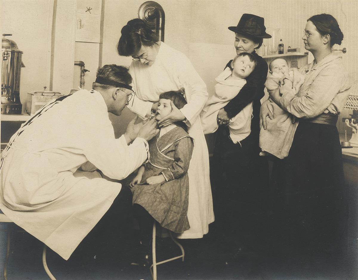 LEWIS W. HINE (1874-1940) Dentist examining child.
