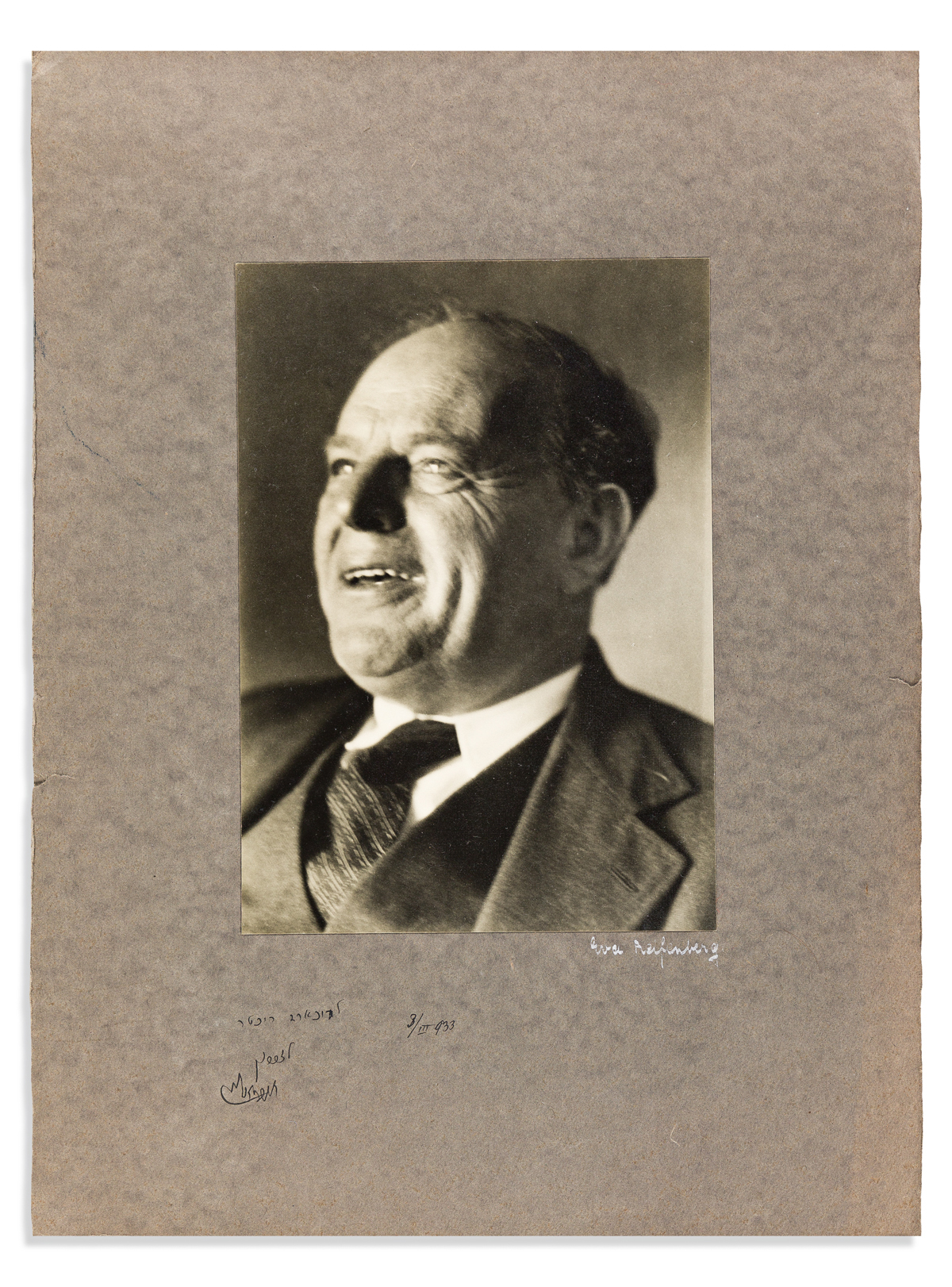 (JUDAICA.) BIALIK, HAYYIM NAHMAN. Two Photographs Signed and Inscribed, in Hebrew, bust portraits by Eva Riefenberg, showing him lookin