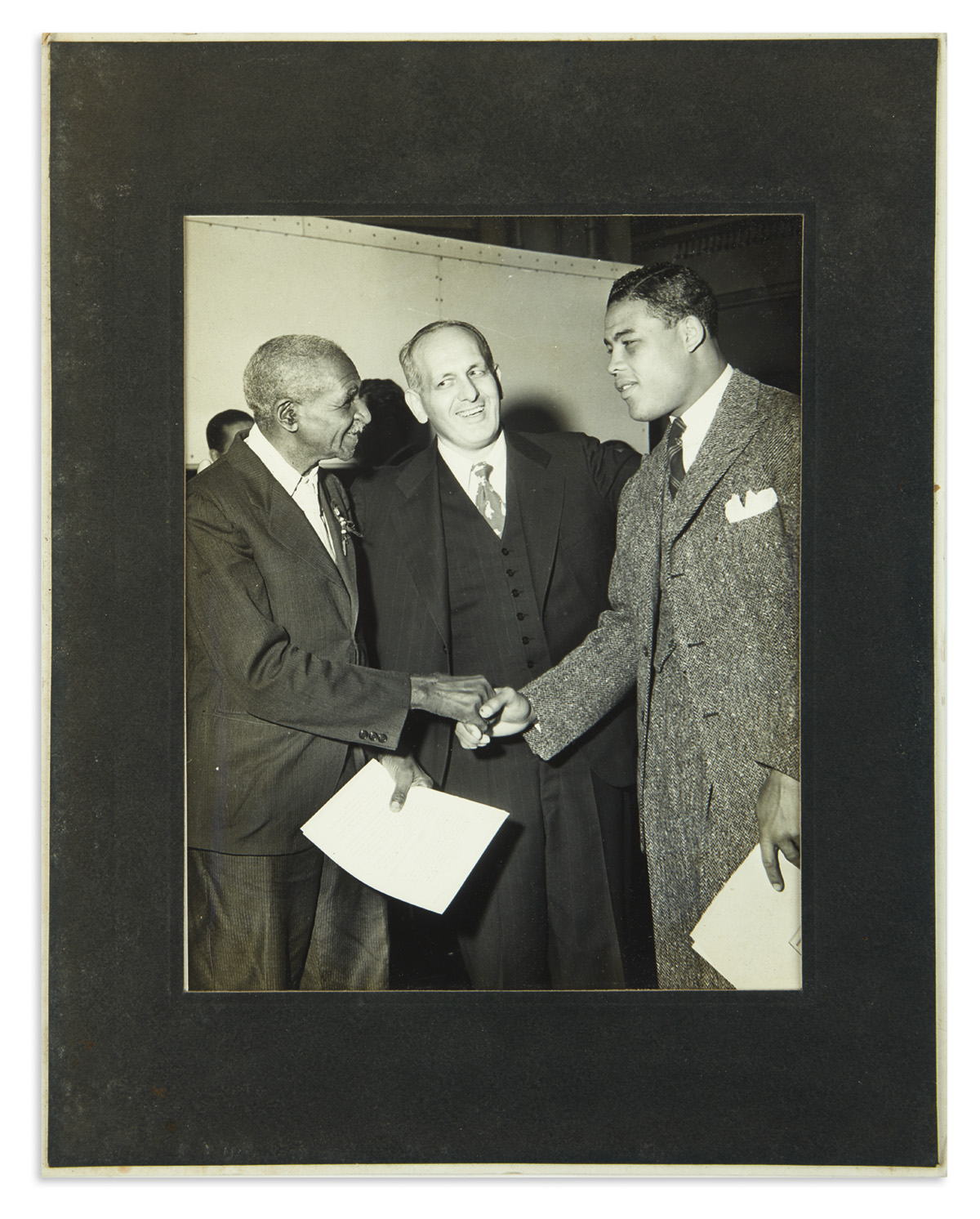 (SPORTS--BOXING.) Archive of photographs of the Brown Bomber, Joe Louis, collected by his manager Julian Black.