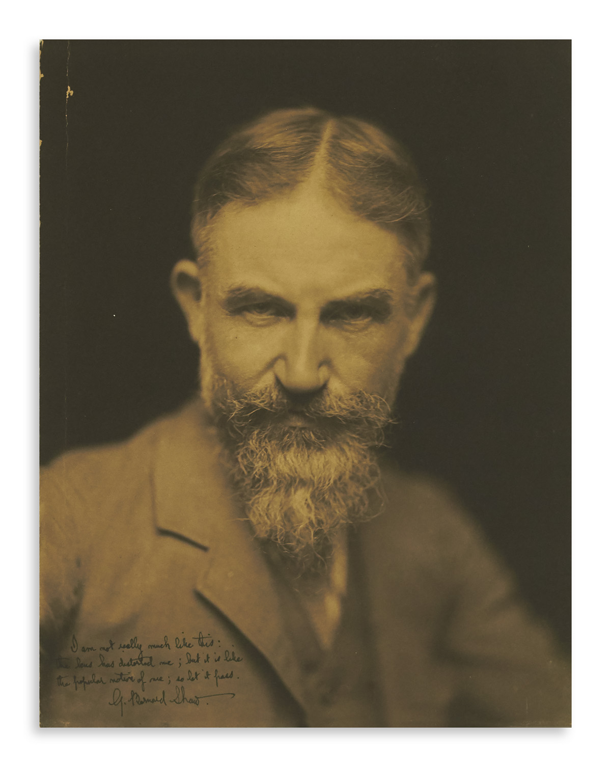 SHAW, GEORGE BERNARD. Photograph Signed and Inscribed, I am not really much like this: / the lens has distorted me; but it is like / t