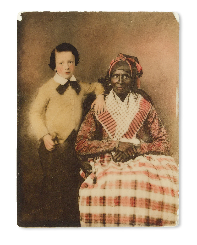 """(PHOTOGRAPHY--EARLY AND CASED IMAGES.) A rare opalotype image of a well-dressed young boy and his seated """"Mammy."""""""