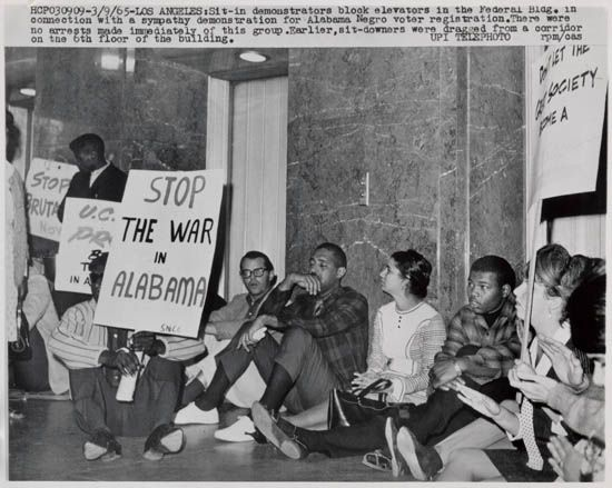(CIVIL RIGHTS RIOTS.) Collection of 32 press photographs of the Watts riots in Los Angeles.