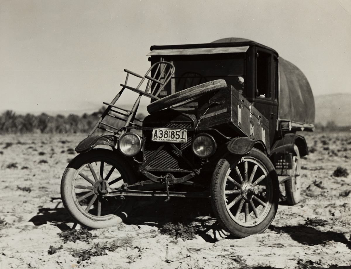 DOROTHEA LANGE (1895-1965) Texas Refugees Car. They are seeking work in the carrot fields of the Coachella Valley, California.
