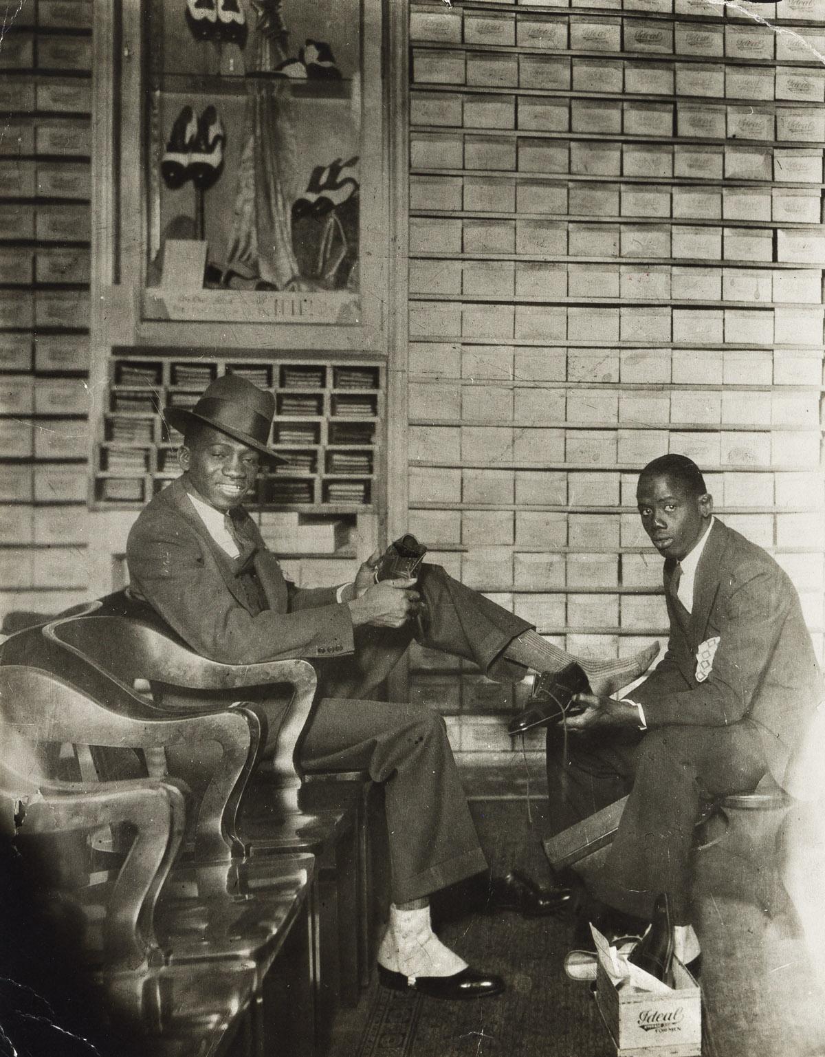 JAMES VANDERZEE (1886 -1983) Shoe Store Salesman and Customer.