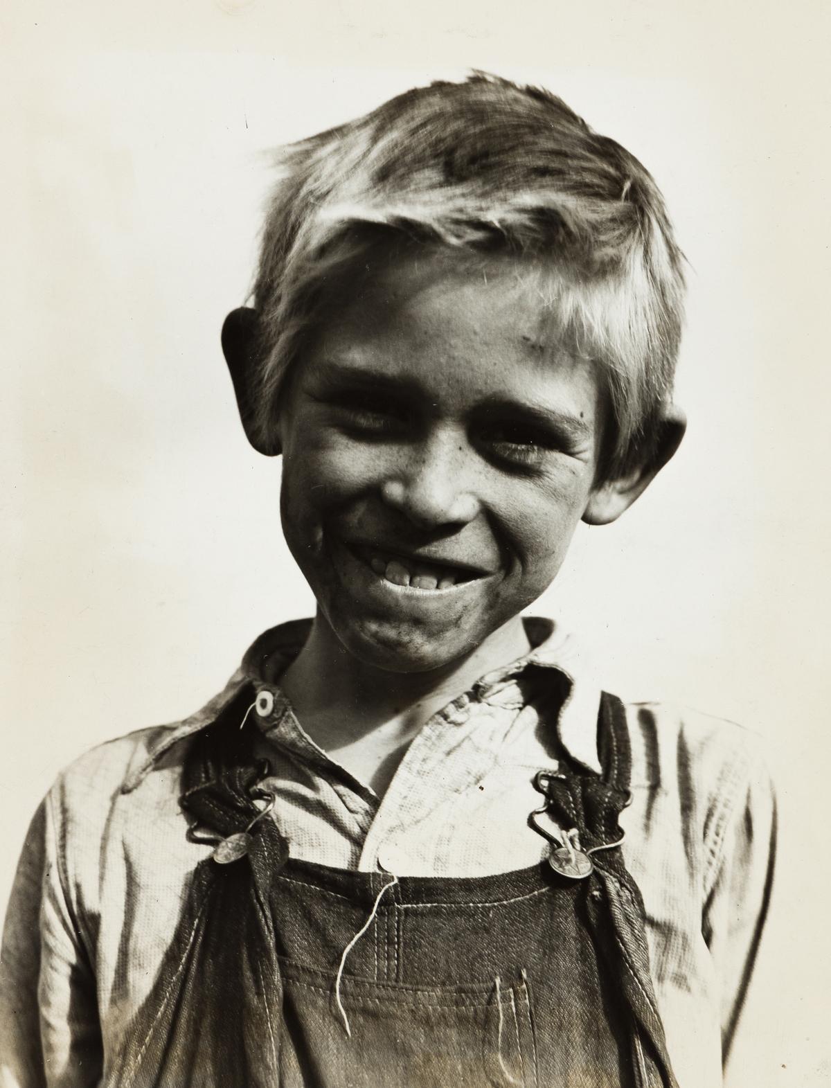 DOROTHEA LANGE (1895-1965) Son of a cotton picker near Farmersville, California.