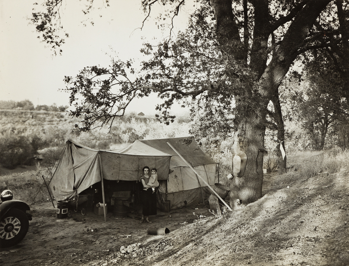 DOROTHEA LANGE (1895-1965) Wife and child of migrant worker encamped near Winters, California. This is a proposed location for a Resett