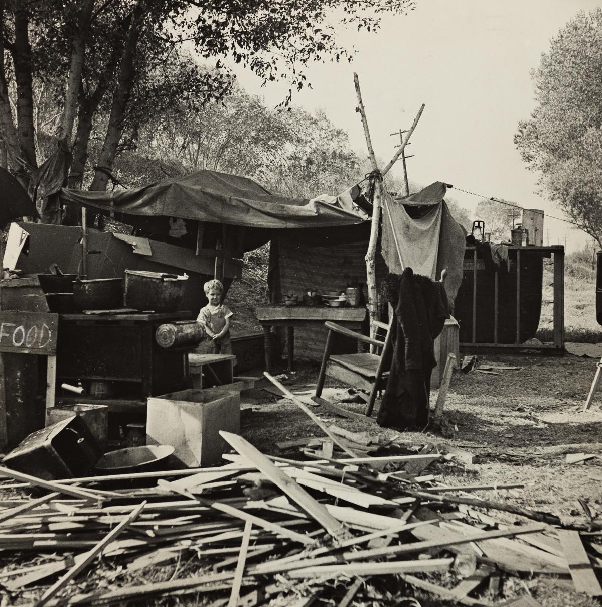 DOROTHEA LANGE (1895-1965) Destitute Family, American River Camp, Sacramento, California.