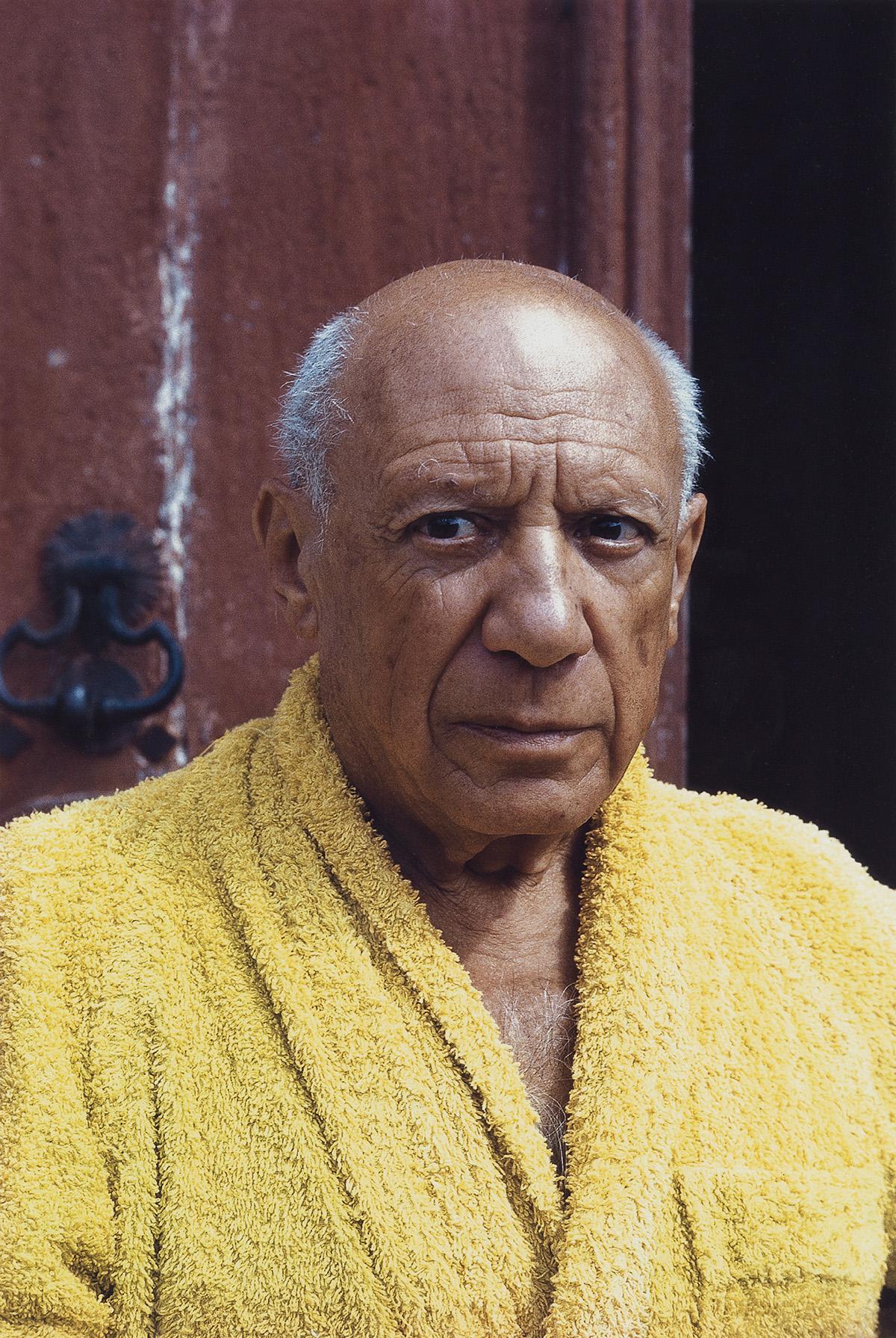DAVID DOUGLAS DUNCAN (1916-2018) Picasso in a yellow bathrobe.