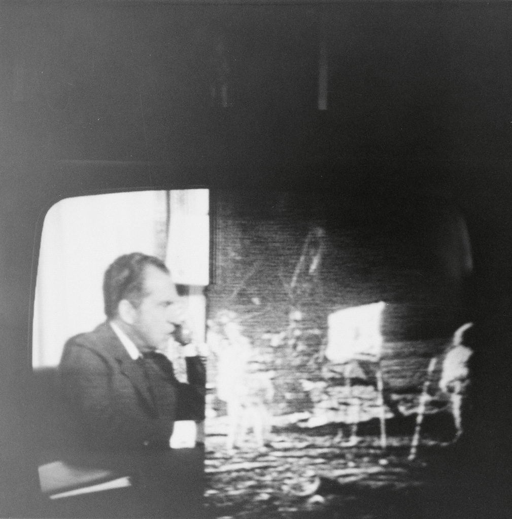 (TELEVISION) Small album with 35 snapshots of a television screen as Apollo 11 made its historic moon landing.