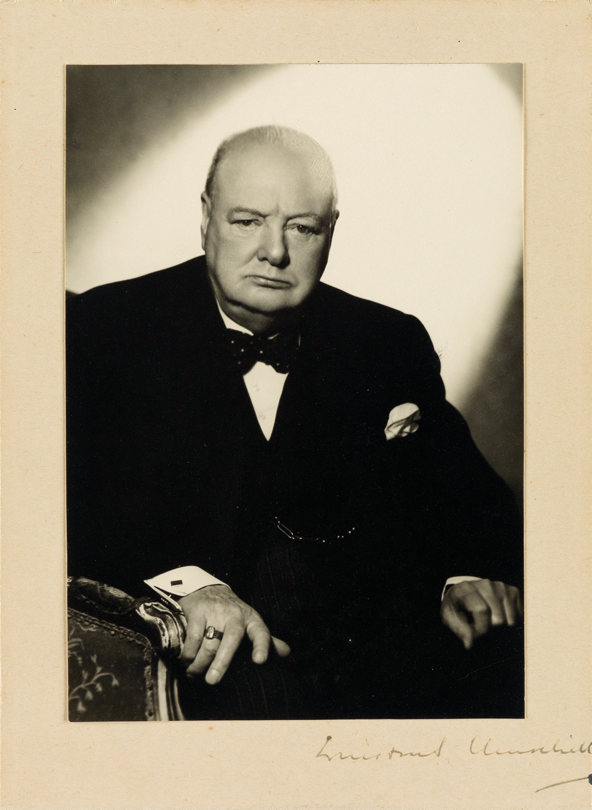 WINSTON S. CHURCHILL. Photograph Signed, half-length portrait by Vivienne, showing him in 1951 seated and looking sternl...