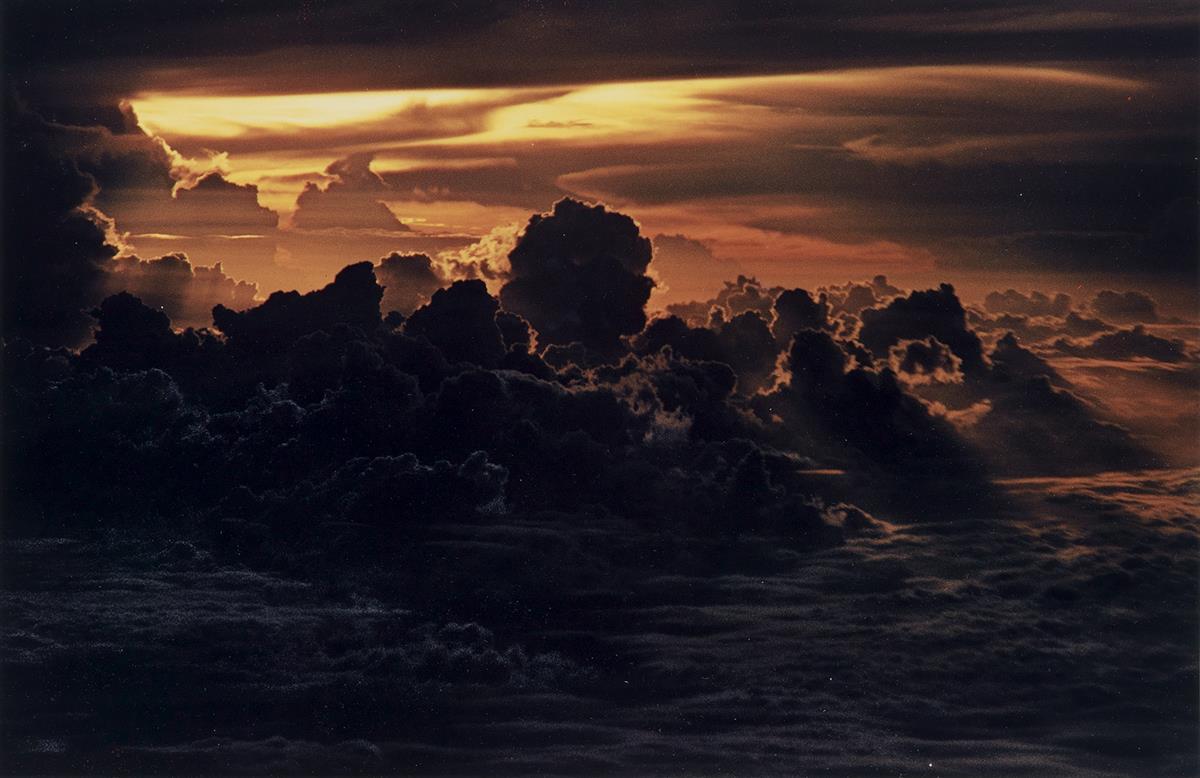 ERNST-HAAS-(1921-1986)-Orange-tinted-clouds