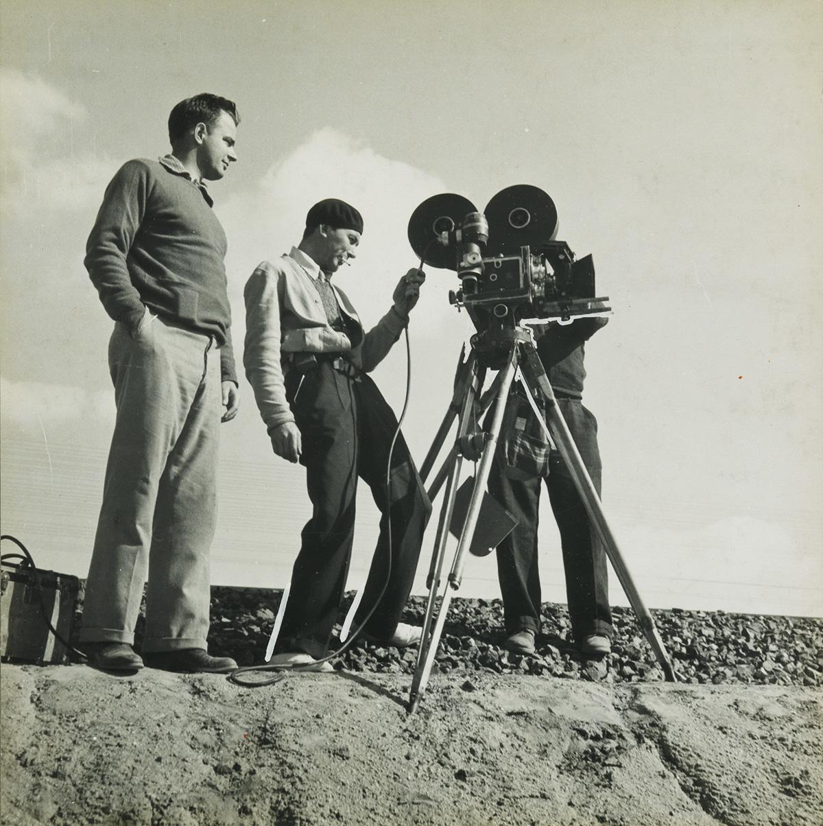 DOROTHEA LANGE (1895-1965) Pare Lorentz and Paul Ivano Making Resettlement Film Near Bakersfield, California.