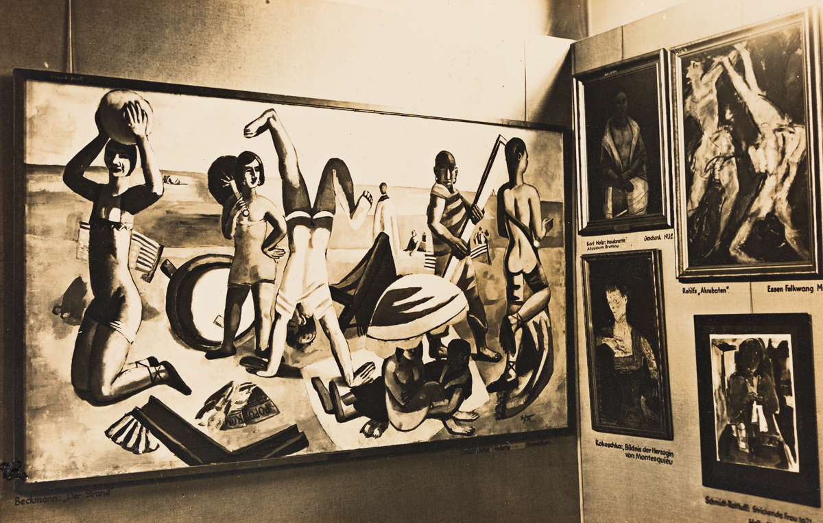 (ENTARTETE KUNST--DEGENERATE ART SHOW) Group of 4 real photo postcards associated with the Munich exhibition, comprising a procession o