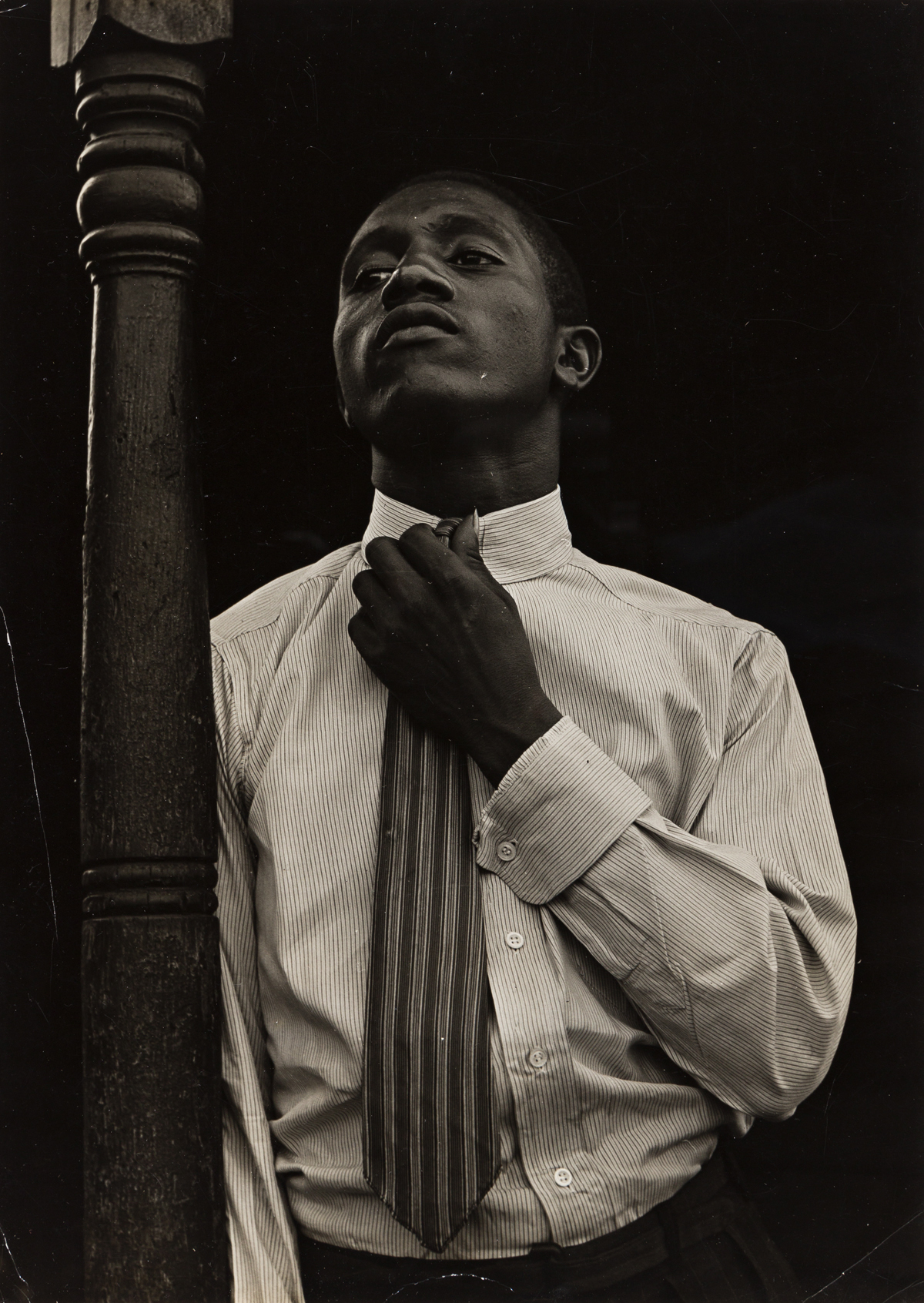 ARTHUR ROTHSTEIN (1915-1985) Portrait of a young African American man.