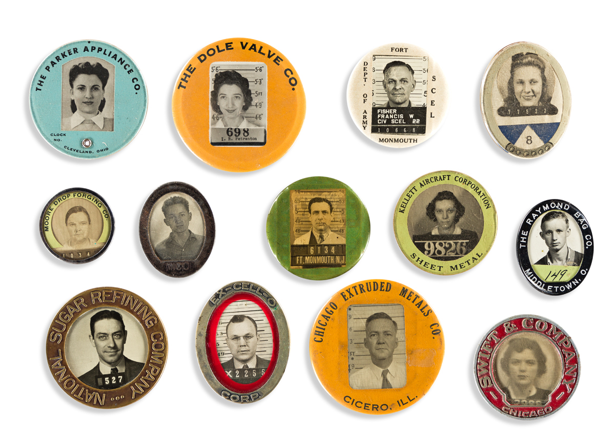 (EMPLOYEE I.D. BADGES) A group of 32 identification badges for manufacturing and military-related companies during and following WWII.