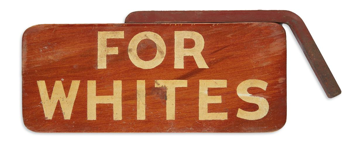 (CIVIL RIGHTS--SEGREGATION.) For Colored / For Whites sign for a segregated bus.