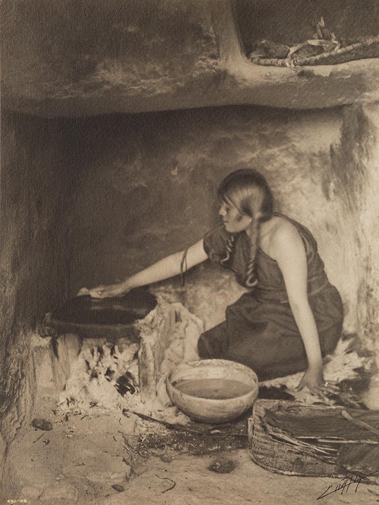 EDWARD S. CURTIS (1868-1952) The Piki Maker.
