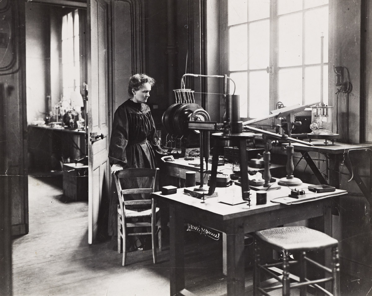 (MADAME CURIE--RADIUM) A group of 6 photographs depicting the Nobel Prize-winning chemist and physicist and her husband and daughter.