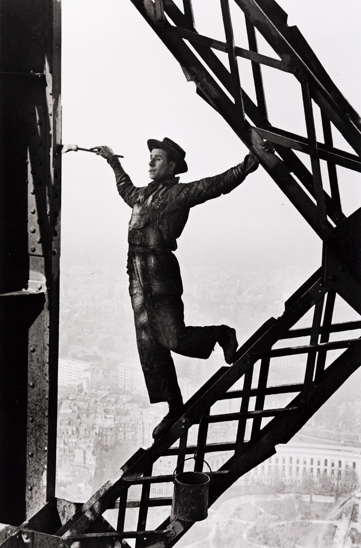 MARC RIBOUD (1923-2016) Painter on the Eiffel Tower, Paris.
