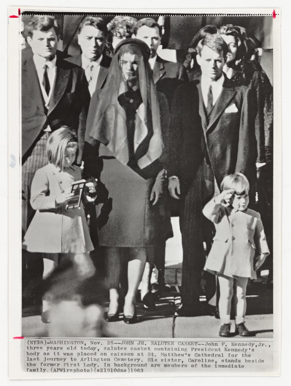DAN FARRELL (1930-2015) John F. Kennedy, Jr. salutes his fathers casket.