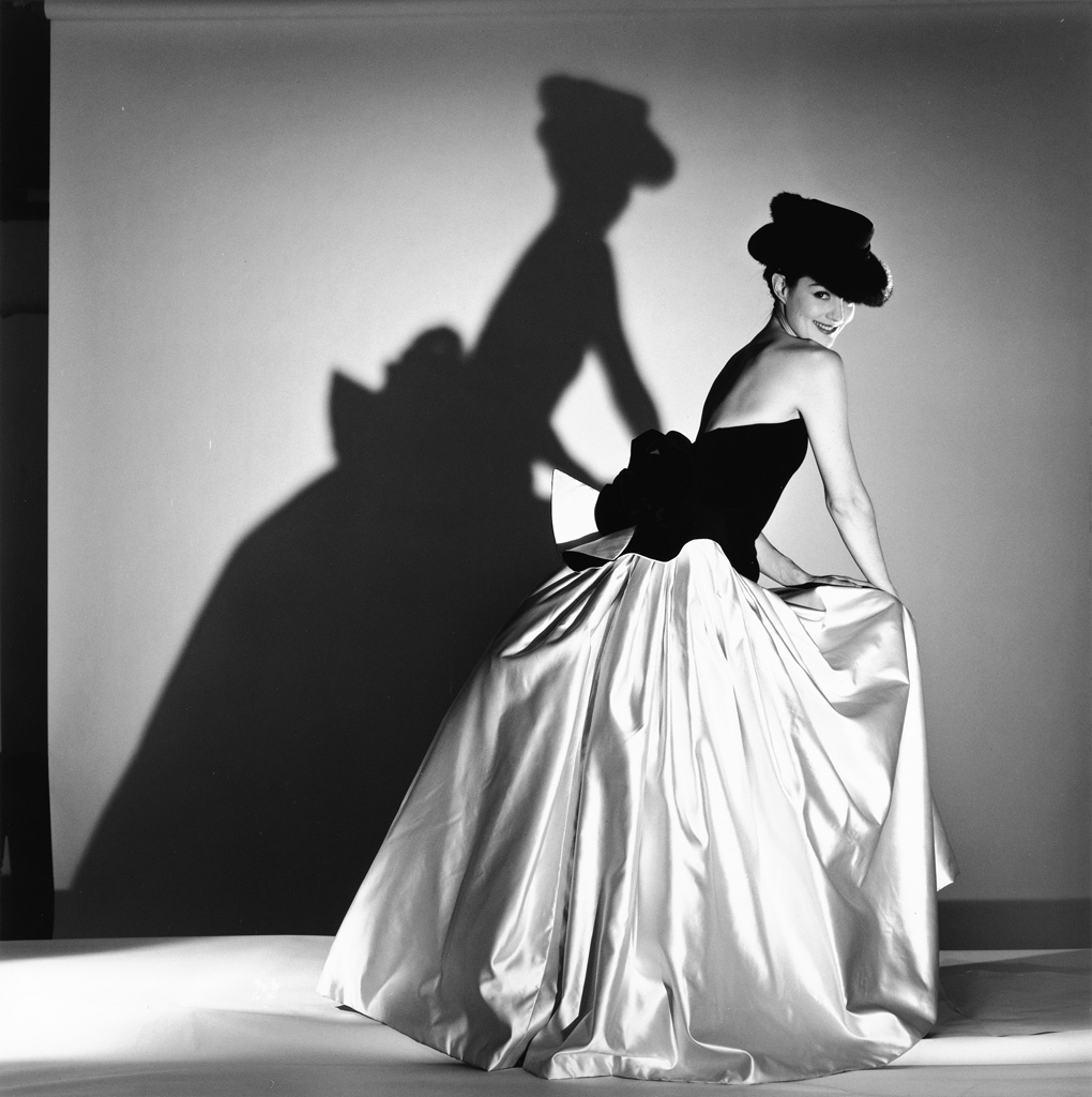 HORST P. HORST (1906-1999) Model in evening gown and hat.