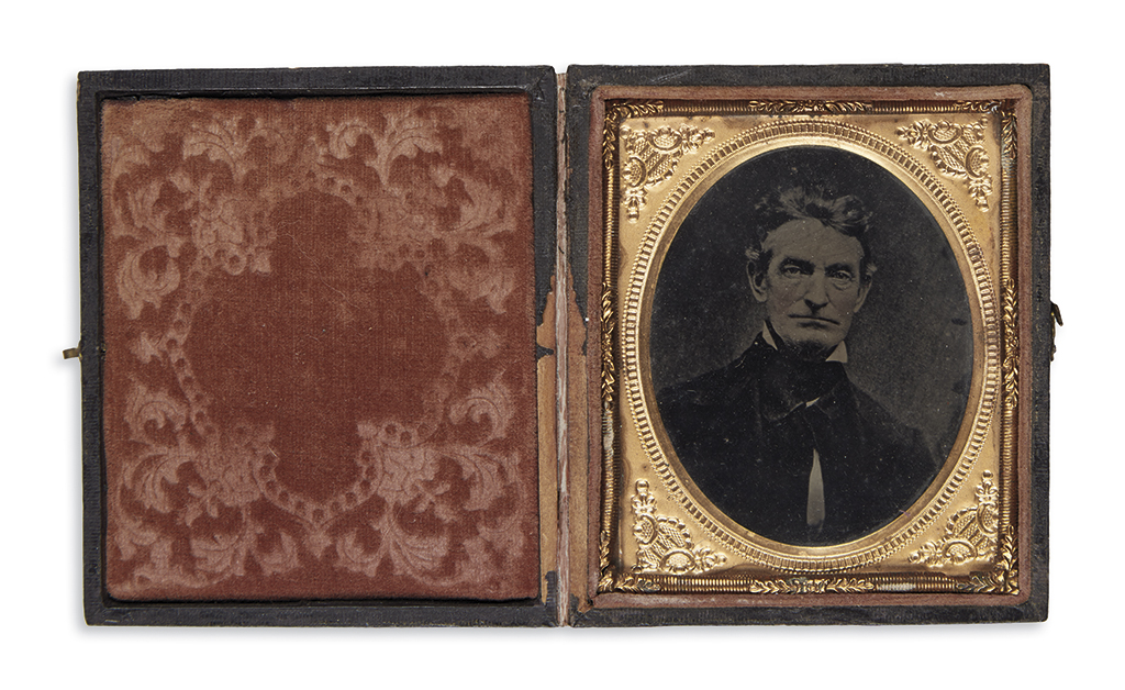 (SLAVERY AND ABOLITION.) Delicately hand-tinted tintype of John Brown.